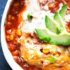 delicious instant pot chili with avocado and sour cream on top