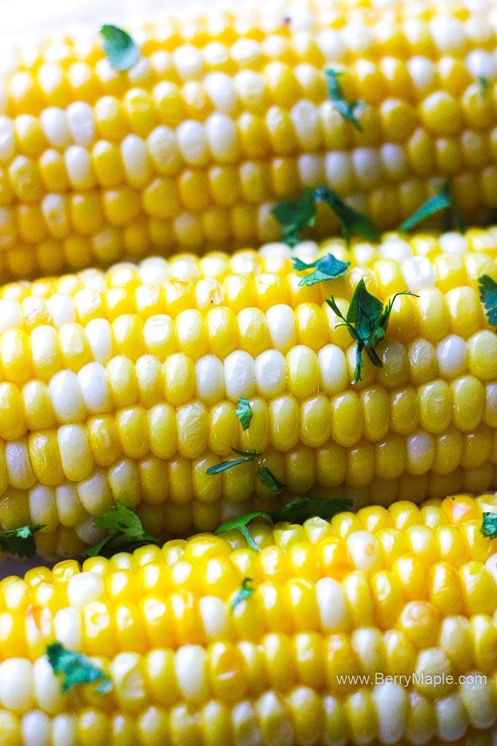 corn on a cob with parsley