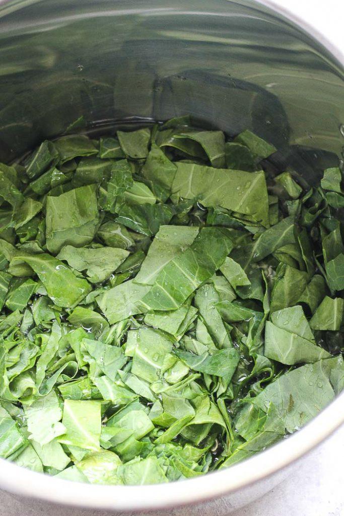 a pot full of chopped collard greens