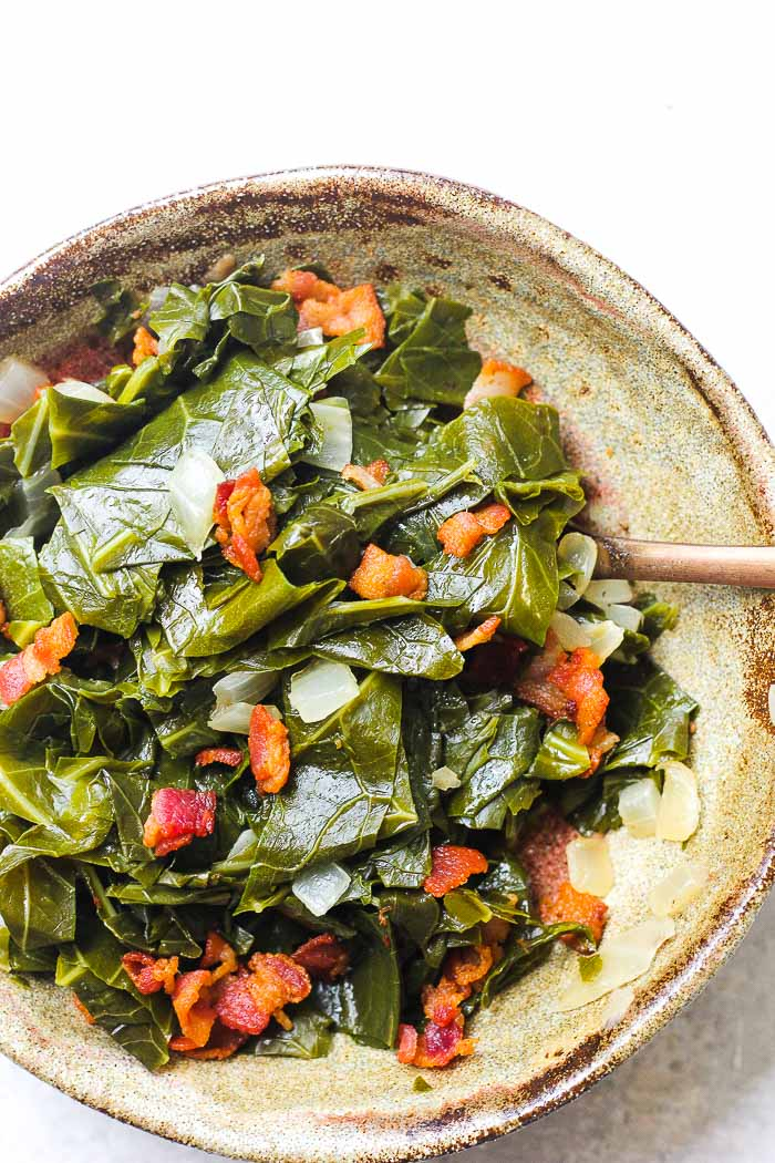 a bowl of southern style collard greens with bacon