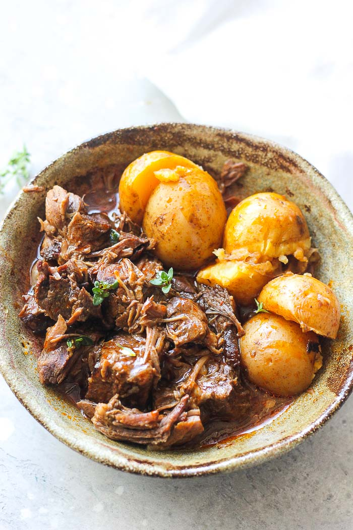 pot roast and potatoes in a bowl