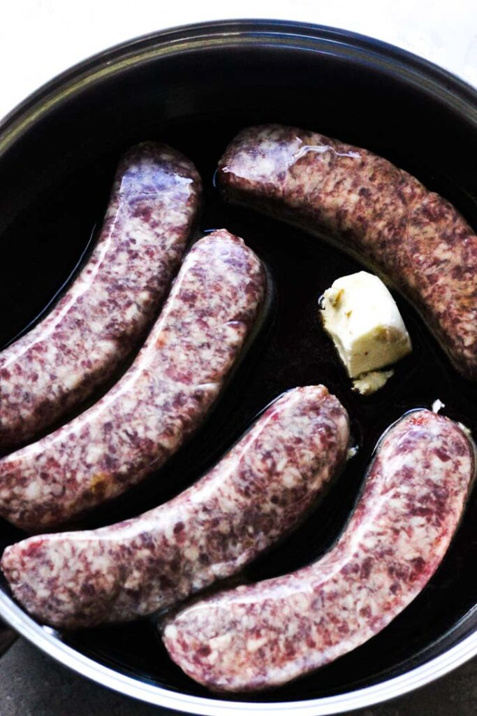 brats with butter in the pan