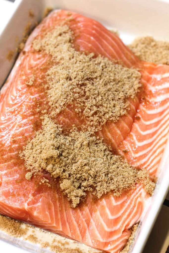 Fresh salmon fillet covered with brown sugar rub