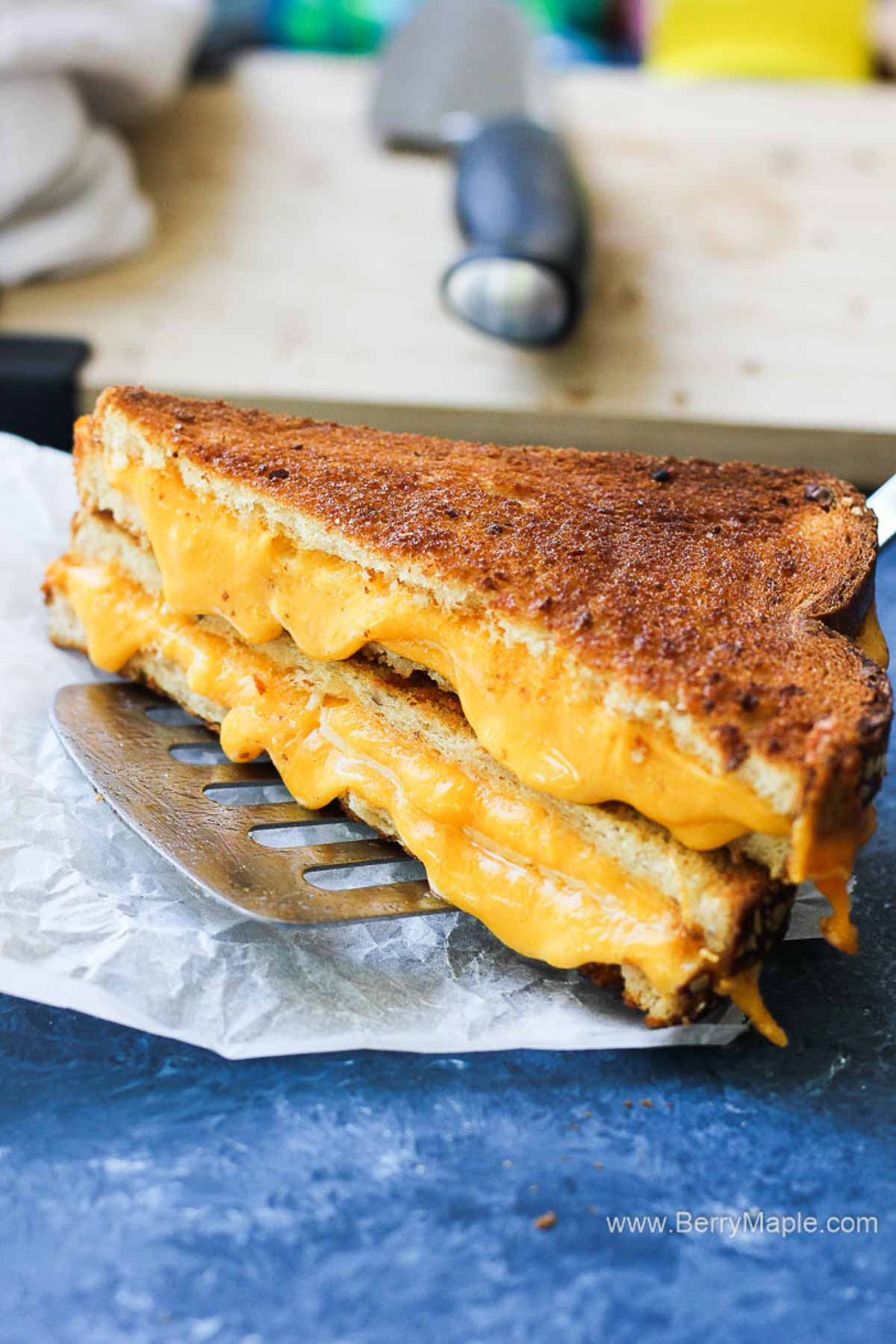 grilled cheese sandwich with melted cheese in the middle
