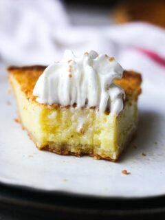 a piece of pie with whipped cream topping