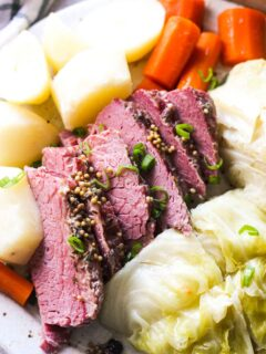 cooked corned beef with carrots, cabbage and potatoes top close view