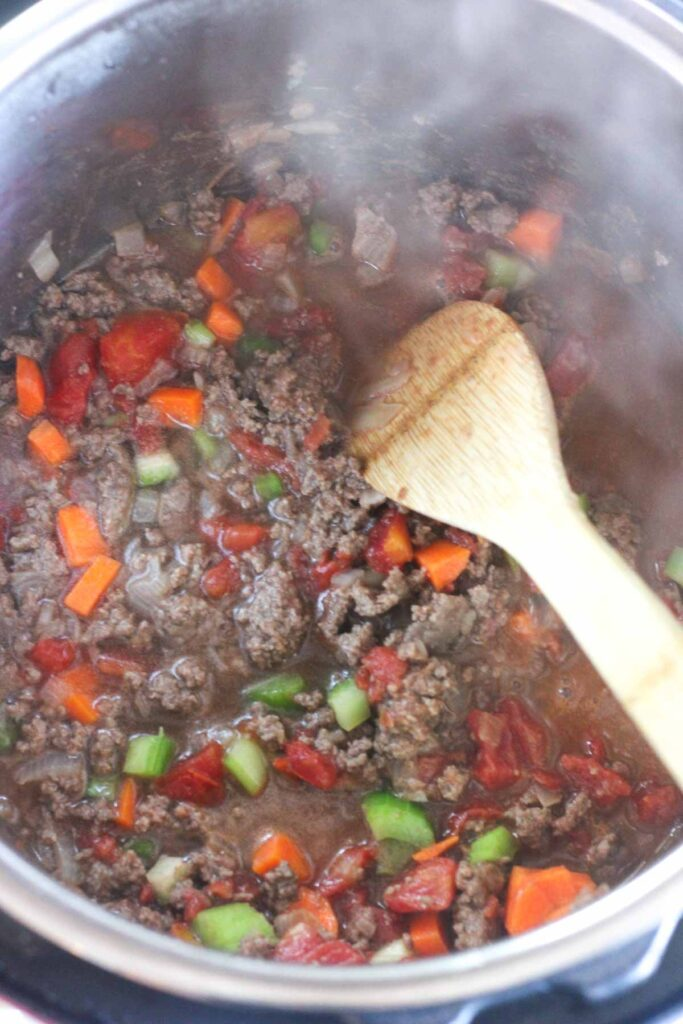 veggies and ground beef in the pressure cooker