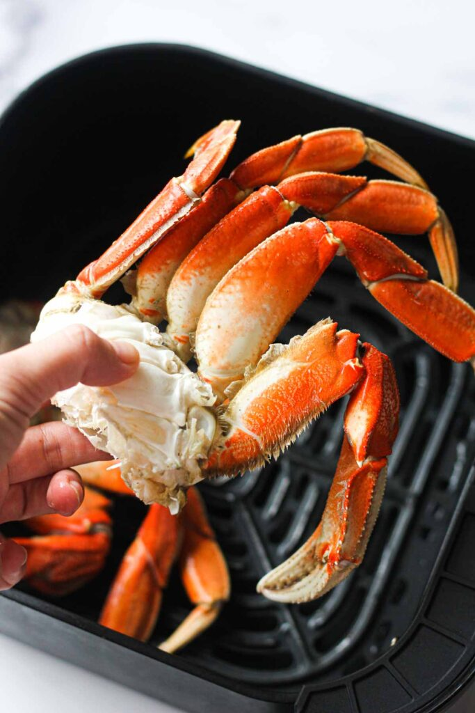 dungeness crab legs in hand