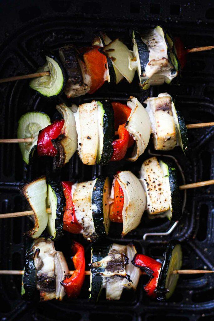 top view of sworfish kebabs in air fryer basket