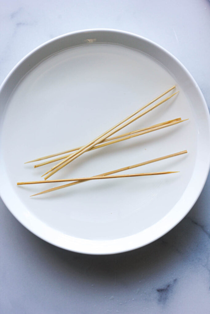 wooden sticks for kebabs soaking in the water