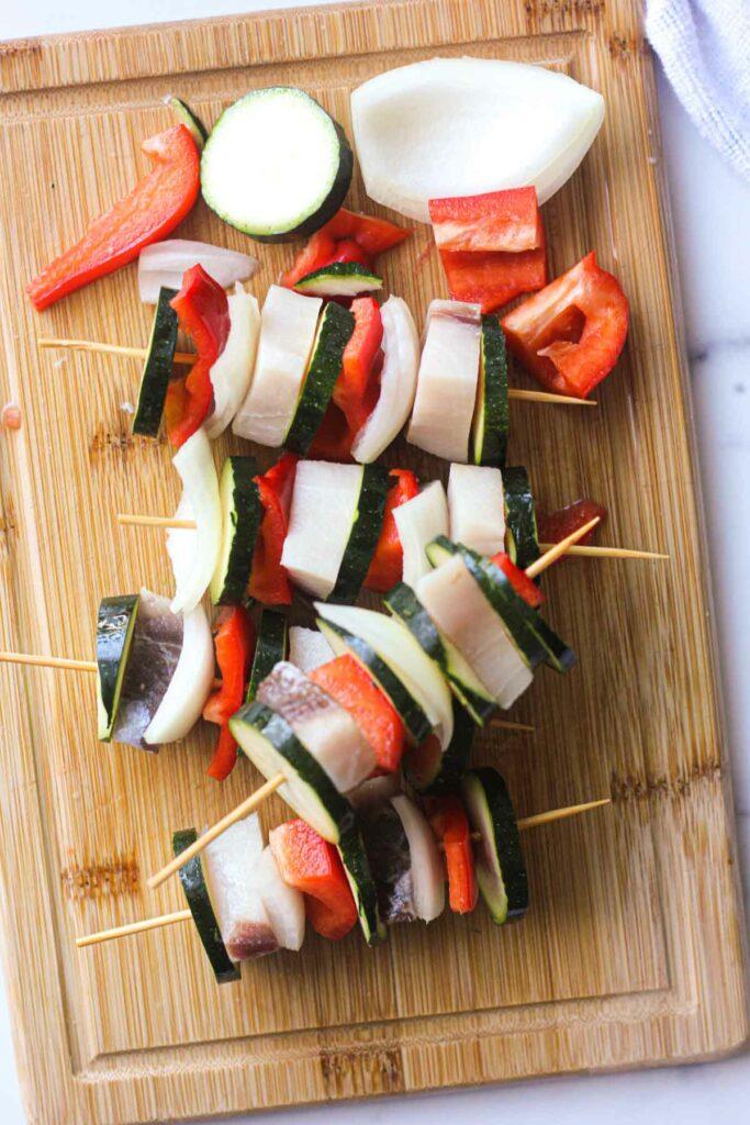raw sworfish kebabs on the cutting board