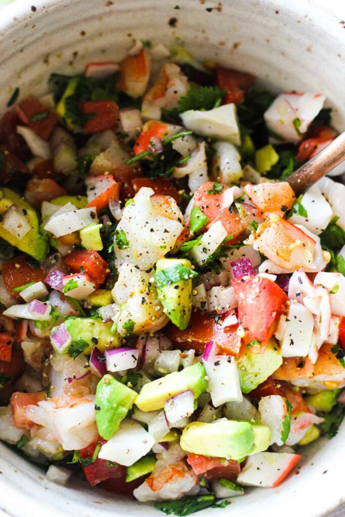 close look at the crab and shrimp salad in the bowl